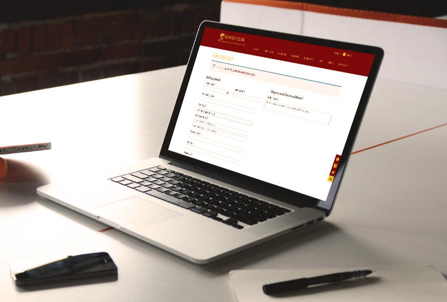 Hawks Club website on a laptop